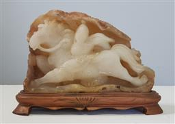 Sale 9183 - Lot 1092 - Oriental themed carved white agate depicting man on horse on timber base (h25cm)
