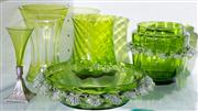 Sale 8470H - Lot 167 - A group of five assorted green glass items including two Victorian frill edged vases, a miniature trumpet vase with plated foot, a B...