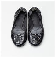 Sale 8740F - Lot 200 - A pair of Tory Burch black patent leather ballet flats with logo applique, approx size 37.5