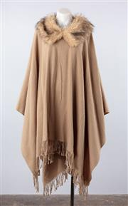 Sale 8760F - Lot 167 - A faux-fur collar camel-tone poncho, all-sizes