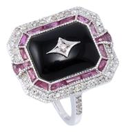 Sale 9054J - Lot 157 - A DECO STYLE DIAMOND RUBY AND ONYX RING; emerald shape cabochon onyx plaque inset with a round brilliant cut diamond to a surround o...