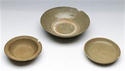Sale 9144 - Lot 433 - Three Ming celadon bowls, as found with chips, (Dia 19cm, 18cm &13cm)