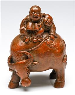 Sale 9255S - Lot 68 - A carved bamboo Chinese figural group of a couple riding buffalo Height 20cm