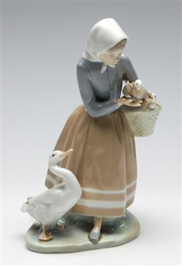 Sale 9253 - Lot 140 - A girl with geese Lladro figural group (H:23cm)