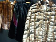 Sale 7982B - Lot 29 - A DKNY faux fur coat together with two other similar