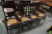 Sale 8500 - Lot 1026 - Set of Six American Pressed and Spindle Back Kitchen Chairs, incl. two armchairs, with rattan seats and stretcher base