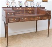 Sale 8515A - Lot 6 - A Carlton House desk in flame mahogany with nine drawers, raised on fluted tapering legs, H 93 x W 135 x D 64cm