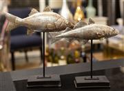 Sale 8709 - Lot 1046 - A pair of graduated silvered fish, Height of taller 35cm