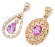 Sale 9083 - Lot 524 - TWO 9CT GOLD STONE SET PENDANTS; an oval pendant set with a pink stone and brilliant cut zirconias length 32mm,  other pear shape ce...