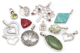 Sale 9132 - Lot 593 - TWELVE SILVER PENDANTS; 4 hearts (1 set with zirconias), 2 tree of life incl Celtic knot and tourmaline set, and 6 stone set incl co...