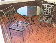 Sale 8270 - Lot 1 - An outdoor table setting, glass top and metal base table, H 75 x D 90cm, with two metal lattice back chairs