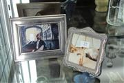 Sale 8311 - Lot 29 - English Hallmarked Sterling Silver Photo Frame & Another Silver Plated Frame (2)