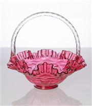 Sale 8473A - Lot 91 - A large Fenton ruby glass basket, decorated by Ronald Farley, H 21 x D 22cm