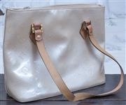 Sale 8800 - Lot 182 - A designer style cream patent leather shoulder bag with matching coin purse, width 30cm, worn