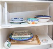 Sale 8593A - Lot 86 - Two shelf lots of kitchen and serving wares including; placemats, lazy susan's, decorative bowls and plates, etc