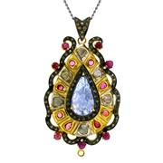 Sale 8050B - Lot 65 - A STERLING SILVER GILT PENDANT; centring a carved drop shape tanzanite surrounded by rubies (treated) and table cut diamonds. Length...