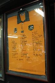 Sale 8125 - Lot 11 - Australian Rugby Wallabies Jersey c.1990 - framed and signed by 36 players incl Campese, Crowley, Daley, Howard, Wilson, Campbell, etc