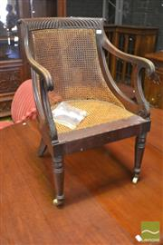 Sale 8291 - Lot 1074 - Regency Mahogany Library Chair, with gadrooned top rail, caned back & seat (various faults & restorations)