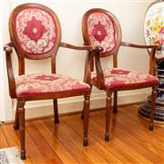 Sale 8882H - Lot 25 - A Pair of Louis XVI style beech arm chairs with padded backs and seats . (faulty upholstery to one)