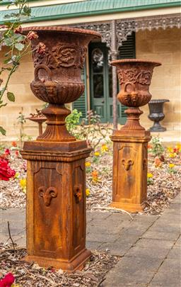 Sale 9191W - Lot 421 - A pair of Cast iron urns with handles. H. Overall 126cm Urn H. 62cm Diam 43cm