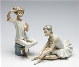 Sale 9253 - Lot 214 - A Nao ballerina (L:19cm) together with a Lladro girl brushing hair - some damage; mirror from left hand taped to belly, repaired