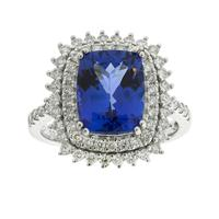 Sale 8221A - Lot 119 - 18ct White Gold Tanzanite Ring; centering an estimated 3.56ct rectangular cushion cut tanzanite, as well as sixty-four round brillia...