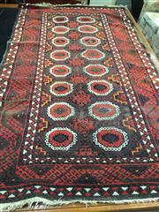 Sale 8634 - Lot 1019 - Possibly Balouch Wool Carpet, with Salor guls and hooked border, in white, red, blue & orange (wear)