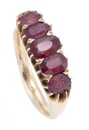 Sale 8915 - Lot 379 - A VINTAGE GOLD RUBY RING; set across the top with five graduated oval cut rubies, gold 10-12ct, size M, wt. 3.63g.