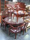 Sale 7920A - Lot 1132 - Circular Mahogany Table with Glass Top and six Regency style chairs