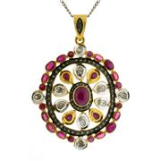 Sale 8050B - Lot 56 - A STERLING SILVER GILT PENDANT; set with a cabochon and mixed cut rubies, table and rose cut diamonds.