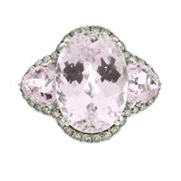 Sale 8221A - Lot 5 - 18ct White Gold Kunzite and Diamond Ring; centering an oval cut kunzite estimated at 6.5ct, as well as two trilliant cut kunzites es...