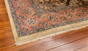 Sale 8882H - Lot 44 - A Chinese wool carpet in the Indo Persian style with floral arabesques in cream and pink, (some wear) 255cm x 246cm