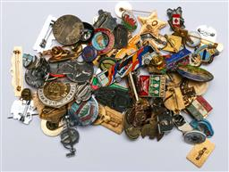 Sale 9144 - Lot 92 - A collection of badges and pins from around the world