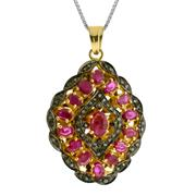 Sale 8060B - Lot 385 - A STERLING SILVER GILT GEM SET PENDANT; set with oval cut rubies (treated) and table cut diamonds.