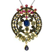 Sale 8060B - Lot 387 - A STERLING SILVER GILT GEM SET PENDANT; set with blue sapphires, rubies, rose and table cut diamonds. Length 65mm.