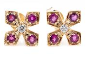 Sale 8905J - Lot 337 - A PAIR OF RUBY AND DIAMOND STUD EARRINGS; 9ct gold quartrefoil tops centring round brilliant cut diamonds to round cut rubies, width...