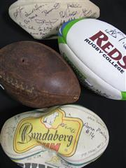 Sale 8125 - Lot 53 - 4 Footballs - QLD Reds ball signed by 10 players incl Nathan Sharpe, Ballymore Lineout ball signed by Pat Howard, David Wilson, Dan...