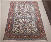 Sale 8486A - Lot 1 - A garden motif Persian carpet with frolicking deer amidst Iznik style foliage on cream ground with red border, 220 x 140cm