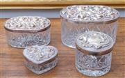 Sale 8800 - Lot 189 - A four piece crystal dressing table box set with silver plated embossed foliate lids