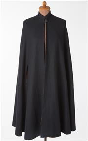 Sale 8550F - Lot 163 - A vintage wool blend long navy cape with holes for hands and single button near neck, one size.