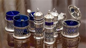Sale 9195H - Lot 29 - A Hardy Brothers hallmarked sterling silver cruet set comprising 3 salts (some damages), 3 peppers, two mustards in pierced decorati...