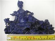 Sale 8064A - Lot 61 - Quan Yin Carved from Dark Sodalite