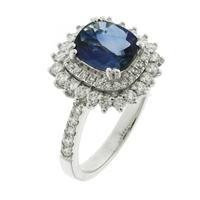 Sale 8221A - Lot 120 - 18ct White Gold Sapphire and Diamond Ring; centering a cushion cut blue sapphire estimated 1.54ct, to surround with fifty-eight roun...