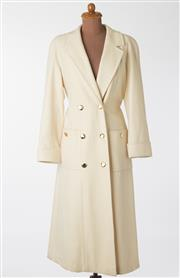 Sale 8550F - Lot 173 - A tailored full length wool blend cream coat with gilt tone buttons and matching belt, size M.