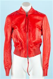 Sale 9083F - Lot 20 - A BALLY RED LEATHER CROSS OVER BACK BOMBER JACKET; open back which is closed by with a separate panel and two Bally studs, elasticat...