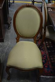 Sale 8093 - Lot 1762 - Set of Four Walnut Chairs with Medallion Backs in Striped Upholstery