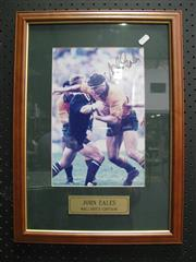 Sale 8125 - Lot 54 - John Eales - signed photograph of Eales in action, framed with COA to reverse