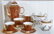 Sale 8470H - Lot 182 - An Adderley bone china tete-a-tete in rouge gilt, together with a French porcelain teapot and sugar bowl with ornithological painted...