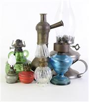 Sale 8957C - Lot 653 - Collection of kerosene lamp bases, some with flutes (some damage)