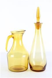 Sale 8972M - Lot 634 - Amber Glass Decanter H:36cm Together With Jug H:23cm